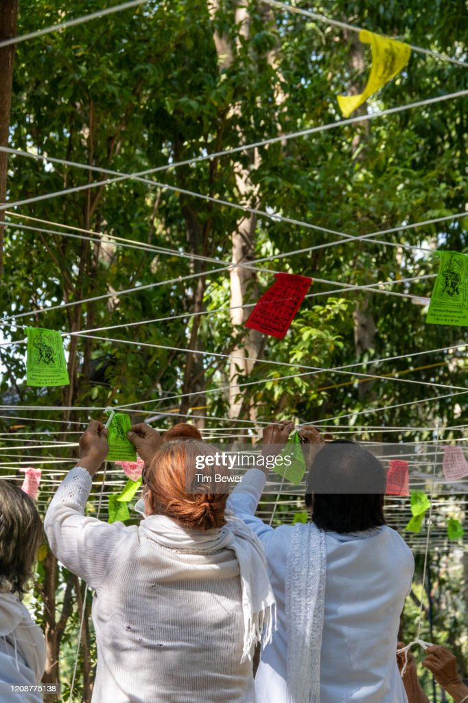 Tying sacred threads during Buddhist ceremony. : Stock Photo