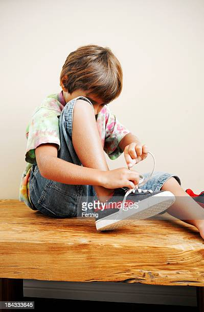Tying shoe laces and getting ready to go