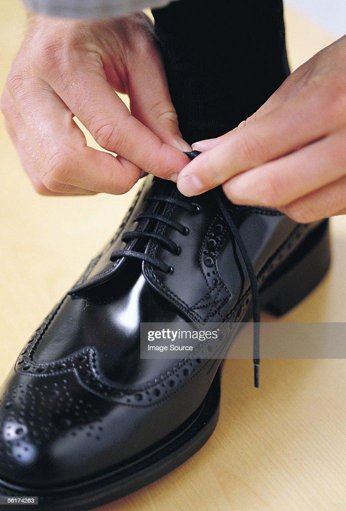 Tying shoe laces : Stock Photo