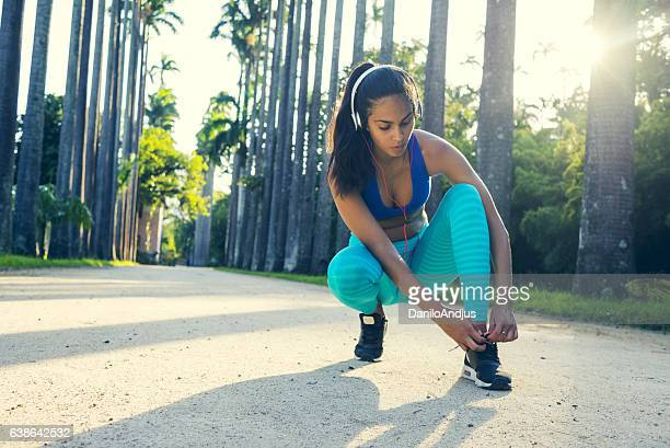 tying shoelaces and preparing for workout