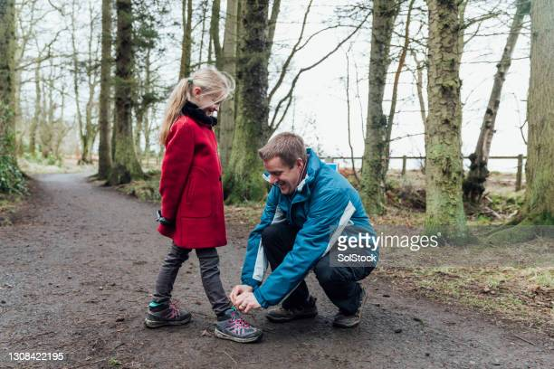 tying up shoelaces - genderblend stock pictures, royalty-free photos & images