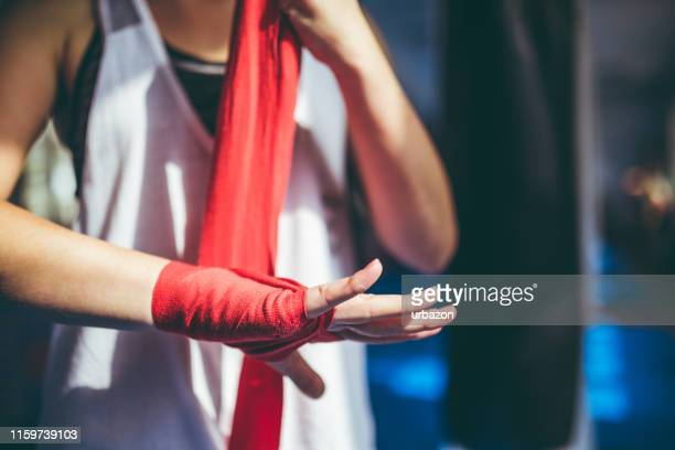 tying up sports glove - combat sport stock pictures, royalty-free photos & images