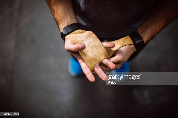 tying up sports glove - protective sportswear stock pictures, royalty-free photos & images