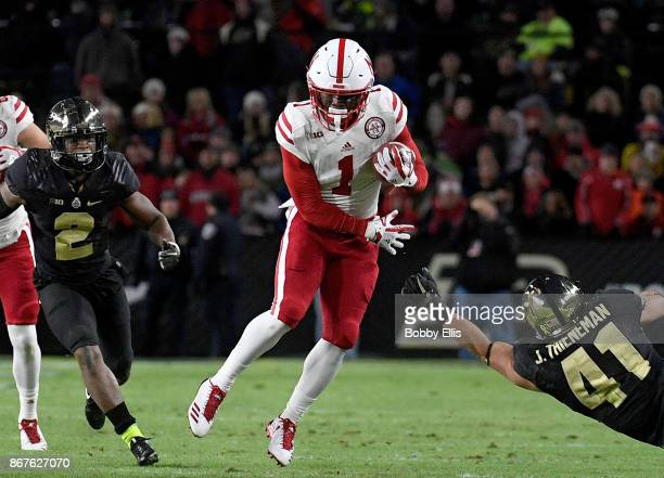 Tyjon Lindsey of the Nebraska Cornhuskers jukes past Jacob Thieneman of the Purdue Boilermakers after a catch during the first quarter of the game...