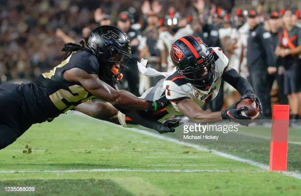 Tyjon Lindsey of the Oregon State Beavers reaches for a touchdown during the game against the Purdue Boilermakers at Ross-Ade Stadium on September 4,...