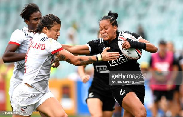 Tyla NathanWong of New Zealand pushes away from the defence in the match against the USA during day one of the 2018 Sydney Sevens at Allianz Stadium...