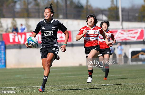 Tyla Nathan-Wong of New Zealand runs for a try past Yume Okuroda of Japan during the Women's Sevens World Series at Fifth Third Bank Stadium on...