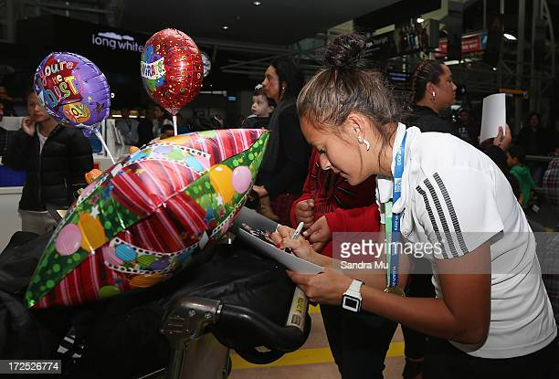 Tyla NathanWong of the New Zealand Woman's Sevens team signs her autograph after arriving at Auckland International Airport on July 3 2013 in...