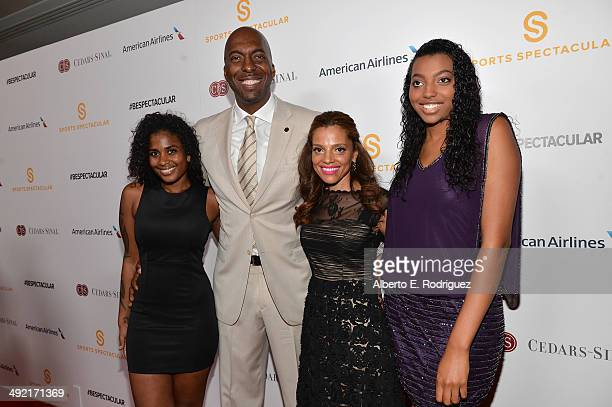 Tyla Salley Natasha Duffy former professional basketball player and radio host John Salley and guest arrive on the red carpet at the 2014 Sports...