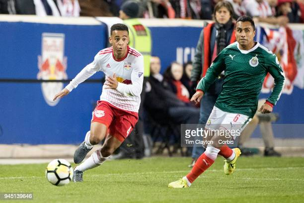 Tyler Adams of New York Red Bulls challenged by Edwin Hernandez of C.D. Guadalajara during the New York Red Bulls Vs C.D. Guadalajara CONCACAF...