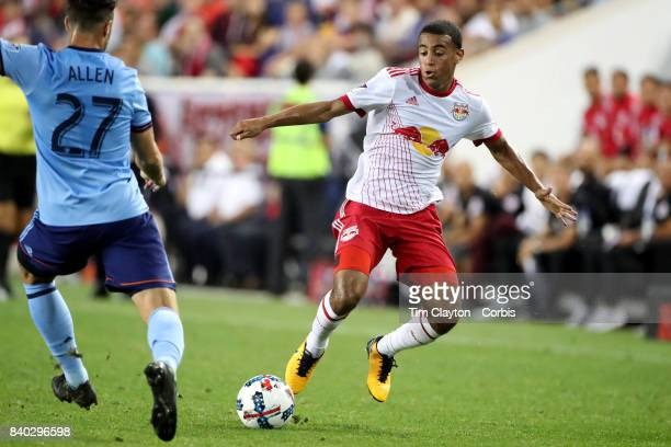 Tyler Adams of New York Red Bulls challenged by RJ Allen of New York City FC during the New York Red Bulls Vs New York City FC MLS regular season...