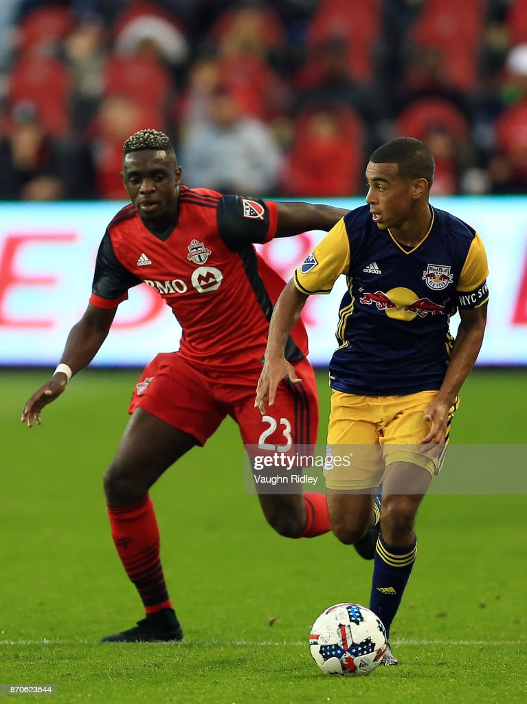 Tyler Adams #4 of New York Red Bulls dribbles the ball as Chris Mavinga #23 of Toronto FC defends during the first half of the MLS Eastern Conference Semifinal, Leg 2 game at BMO Field on November 5, 2017 in Toronto, Ontario, Canada.