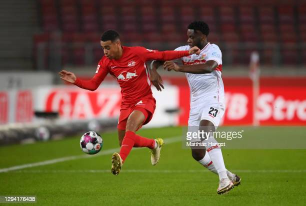 Tyler Adams of RB Leipzig and Orel Mangala of VfB Stuttgart battle for possession during the Bundesliga match between VfB Stuttgart and RB Leipzig at...