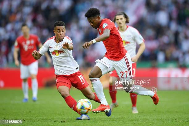 Tyler Adams of RB Leipzig battles for possession with David Alaba of Bayern Munich during the DFB Cup final between RB Leipzig and Bayern Muenchen at...