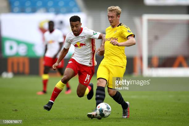 Tyler Adams of RB Leipzig battles for possession with Julian Brandt of Borussia Dortmund during the Bundesliga match between RB Leipzig and Borussia...