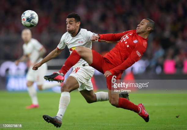 Tyler Adams of RB Leipzig battles for possession with Thiago Alcantara of Bayern Munich during the Bundesliga match between FC Bayern Muenchen and RB...