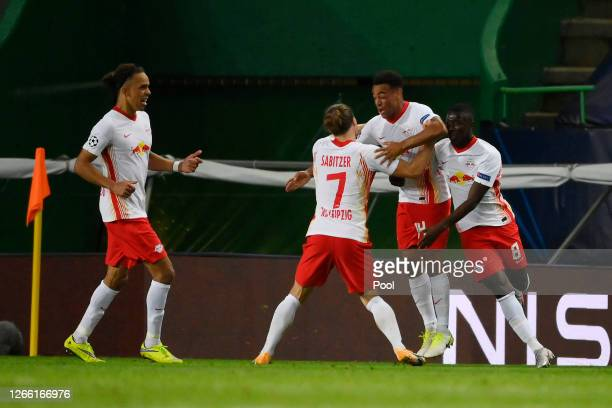 Tyler Adams of RB Leipzig celebrates with teammates after scoring his team's second goal during the UEFA Champions League Quarter Final match between...