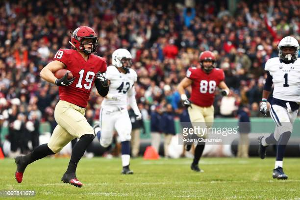 Tyler Adams of the Harvard Crimson runs the football in for a touchdown in the second quarter of a game against the Yale Bulldogs at Fenway Park on...