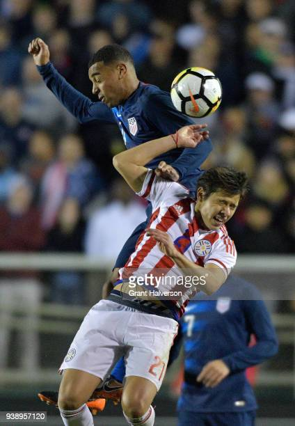 Tyler Adams of United States battles Oscar Romero of Paraguay for a header during their game at WakeMed Soccer Park on March 27 2018 in Cary North...