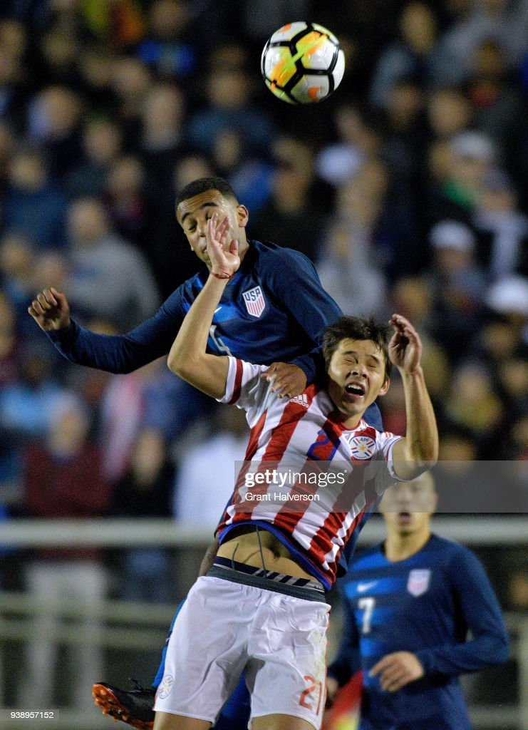 Tyler Adams #4 of United States battles Oscar Romero #21 of Paraguay for a header during their game at WakeMed Soccer Park on March 27, 2018 in Cary, North Carolina. The United States won 1-0.