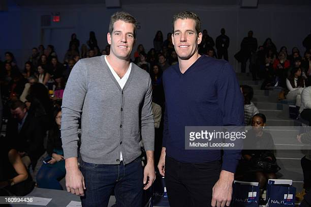 Tyler and Cameron Winklevoss attend the Nautica Men's Fall 2013 fashion show during MercedesBenz Fashion Week at The Stage at Lincoln Center on...