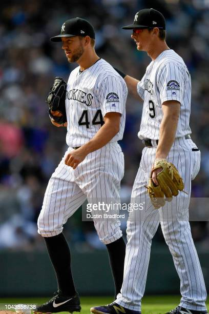 Tyler Anderson of the Colorado Rockies is congratulated by DJ LeMahieu after pitching 7 2/3 shutout innings against the Washington Nationals at Coors...