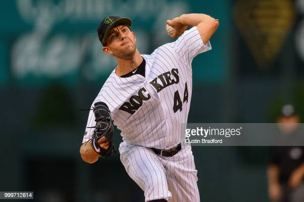 Tyler Anderson of the Colorado Rockies pitches against the Seattle Mariners as heavy rain falls in the second inning of a game against the Seattle...