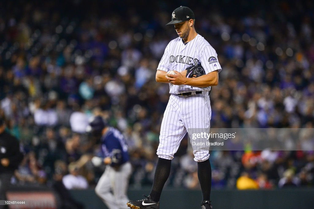 tyler anderson of the colorado rockies reacts after allowing a sixth