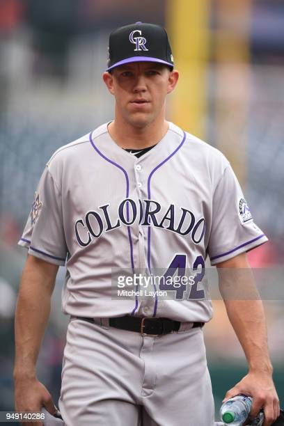 Tyler Anderson of the Colorado Rockies walks to the dug out before a baseball game against the Washington Nationals at Nationals Park on April 15...