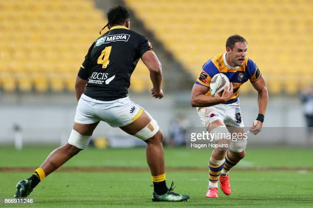 Tyler Ardron of Bay of Plenty attempts to evade Sam Lousi of Wellington during the Mitre 10 Cup Championship Final match between Wellington and Bay...