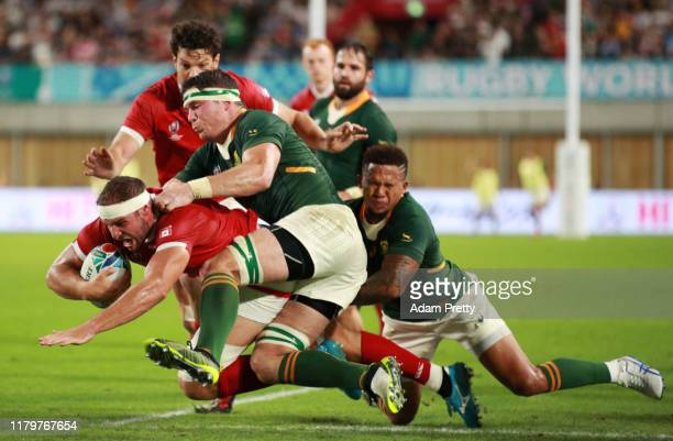 Tyler Ardron of Canada is tackled by Francois Louw and Elton Jantjies of South Africa during the Rugby World Cup 2019 Group B game between South...