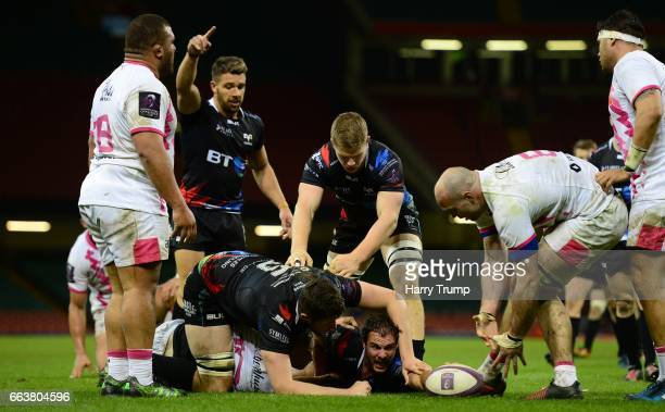 Tyler Ardron of Ospreys scores his sides try during the European Rugby Challenge Cup match between Ospreys and Stade Francais Paris at the...