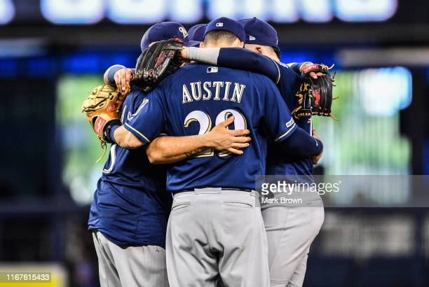 Tyler Austin and of the Milwaukee Brewers teammates gather after the game against the Miami Marlins at Marlins Park on September 12, 2019 in Miami,...