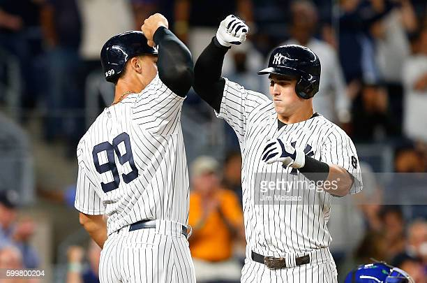 Tyler Austin of the New York Yankees celebrates his tworun home run with teammate Aaron Judge in the seventh inning against the Toronto Blue Jays at...