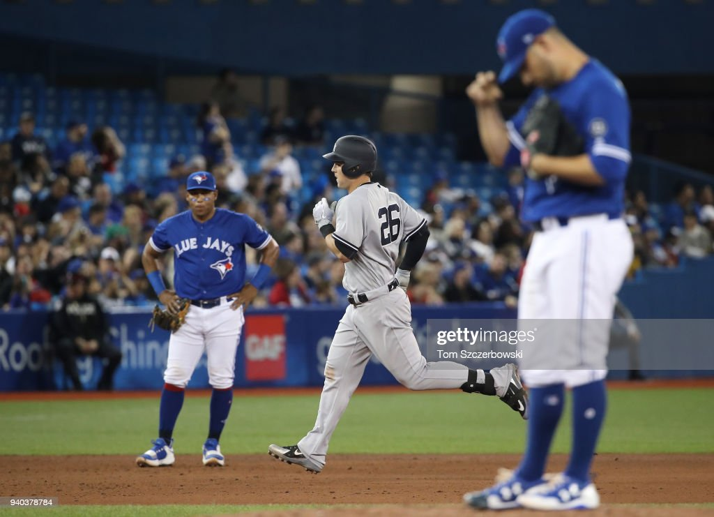Tyler Austin #26 of the New York Yankees circles the bases after hitting a two-run home run in the fifth inning during MLB game action as Marco Estrada #25 of the Toronto Blue Jays reacts at Rogers Centre on March 31, 2018 in Toronto, Canada.