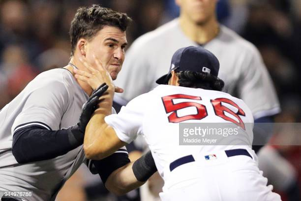 Tyler Austin of the New York Yankees fights Joe Kelly of the Boston Red Sox during the seventh inning at Fenway Park on April 11 2018 in Boston...
