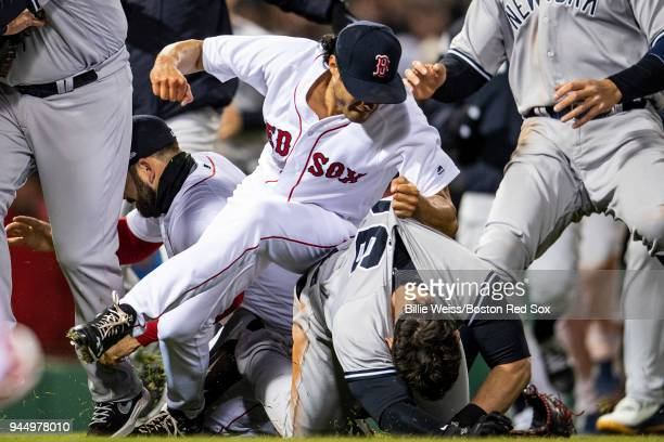 Tyler Austin of the New York Yankees fights with Joe Kelly of the Boston Red Sox after being hit by a pitch during the seventh inning of a game on...
