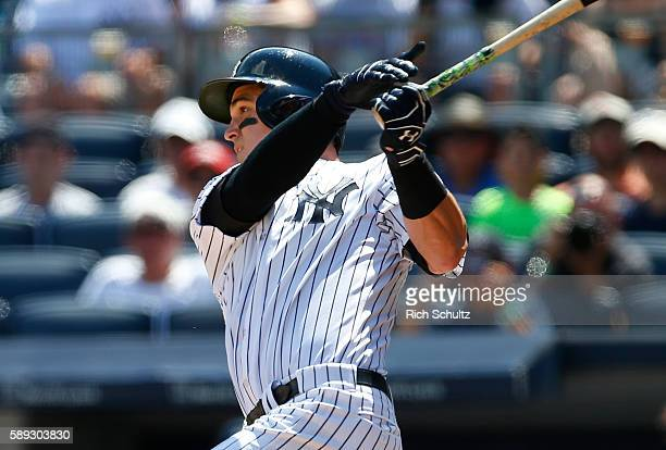 Tyler Austin of the New York Yankees hits a home run in his first MLB at bat during the second inning of a game against the Tampa Bay Rays at Yankee...