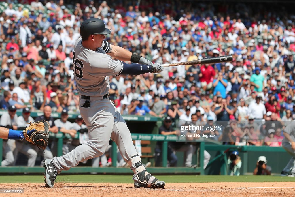Tyler Austin #26 of the New York Yankees hits the single that scored Aaron Judge as the go-ahead run agaisnt the Texas Rangers in the 9th inning of a game at Globe Life Park in Arlington on September 9, 2017 in Arlington, Texas.