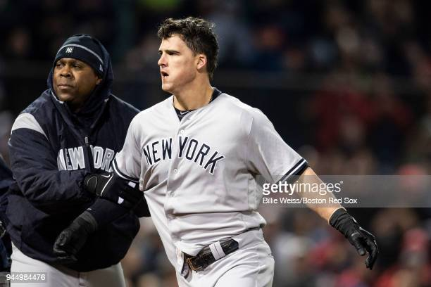 Tyler Austin of the New York Yankees reacts as he is ejected from the game after being hit by a pitch by Joe Kelly of the Boston Red Sox after being...