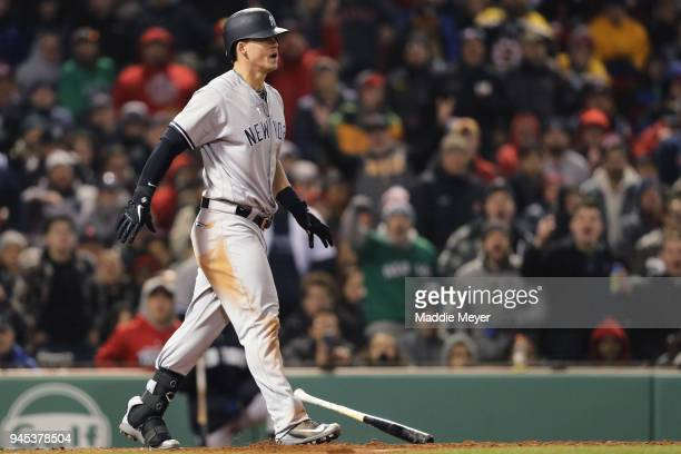 Tyler Austin of the New York Yankees tosses his bat before rushing the pitchers mound after being struck by a pitch from Joe Kelly of the Boston Red...