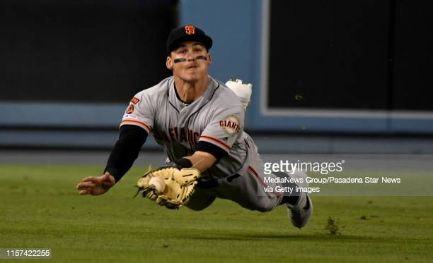 June 19: Tyler Austin of the San Francisco Giants makes a diving catch on a fly ball by Cody Bellinger of the Los Angeles Dodgers in the fifth inning...