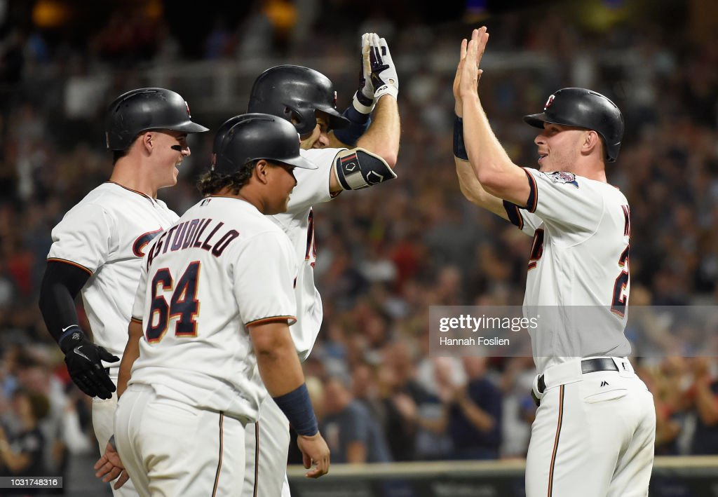 Tyler Austin #31, Willians Astudillo #64, Joe Mauer #7 and Max Kepler #26 of the Minnesota Twins celebrate a grand slam by Mauer against the New York Yankees during the fifth inning of the game on September 11, 2018 at Target Field in Minneapolis, Minnesota.