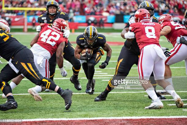 Tyler Badie of the Missouri Tigers runs the ball up the middle for a touchdown in the second half of a game against the Arkansas Razorbacks at War...