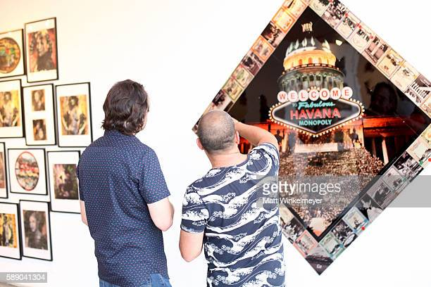 Tyler Barth and artist Kadir Lopez attend Kadir Lopez's Art Show on August 12 2016 in West Hollywood California