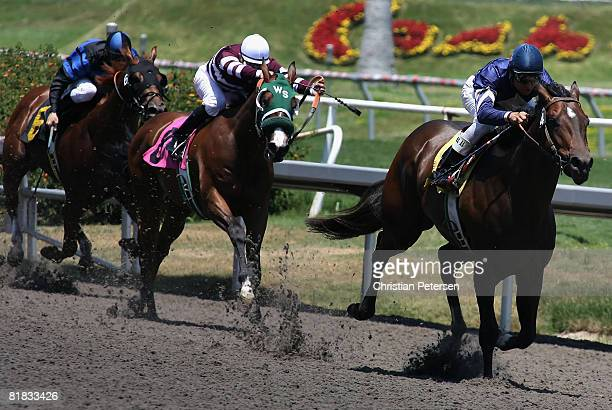 Tyler Baze riding Mind the Minister leads Richard Migilore riding Lightning Hit and Alex Solis riding Tycoon Doby in the 4th race of the 2008...