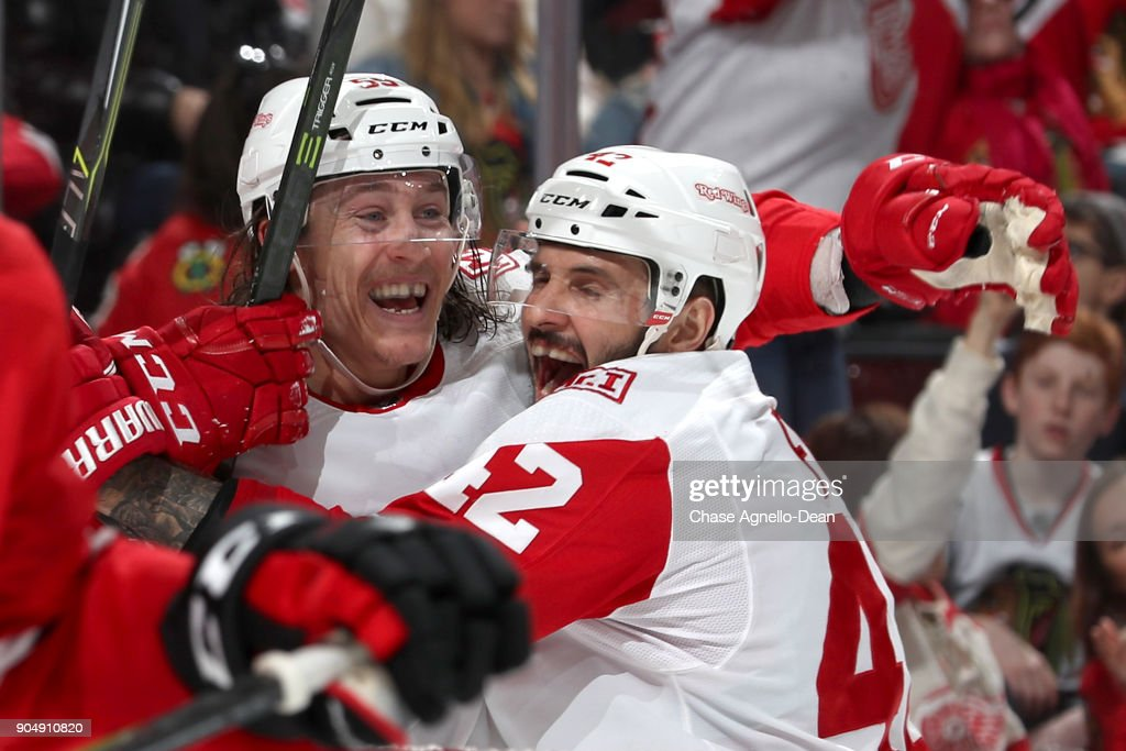 Tyler Bertuzzi #59 and Martin Frk #42 of the Detroit Red Wings celebrate after Bertuzzi scored against the Chicago Blackhawks in the third period at the United Center on January 14, 2018 in Chicago, Illinois.