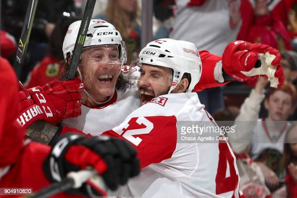 Tyler Bertuzzi and Martin Frk of the Detroit Red Wings celebrate after Bertuzzi scored against the Chicago Blackhawks in the third period at the...