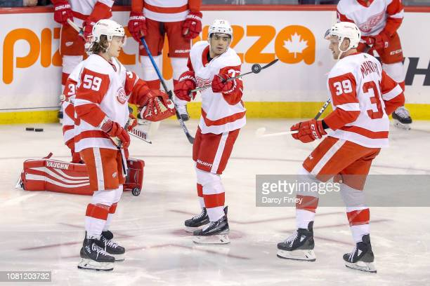 Tyler Bertuzzi Andreas Athanasiou and Anthony Mantha of the Detroit Red Wings take part in the pregame warm up prior to NHL action against the...