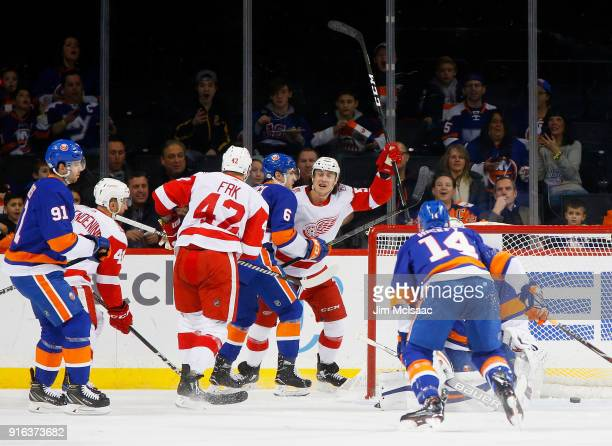 Tyler Bertuzzi of the Detroit Red Wings celebrates a first period goal by teammate Martin Frk against the New York Islanders at Barclays Center on...